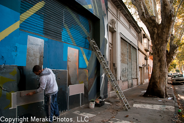Photo of graffiti artist at work