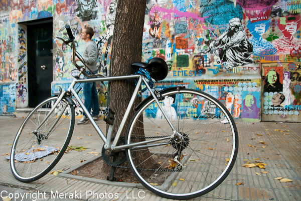 Photos of bike against graffiti wall