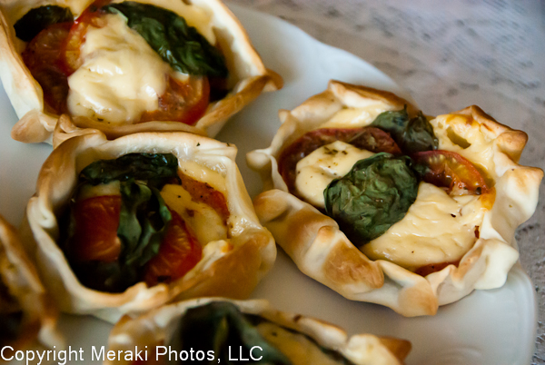 Photo of cooked caprese empanadas