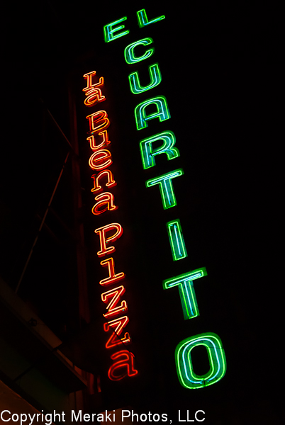 Photo of El Cuartito Sign